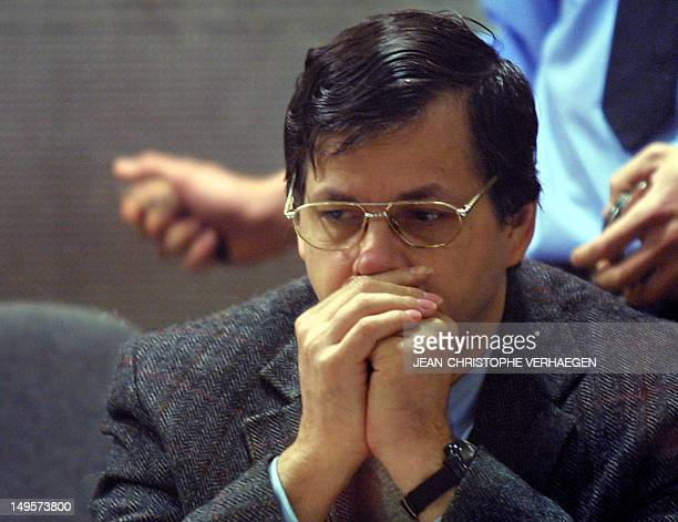 Belgian child kidnapper and rapist Marc Dutroux is seen at the start of the morning session of his trial at the Arlon courthouse 06 May 2004 The...