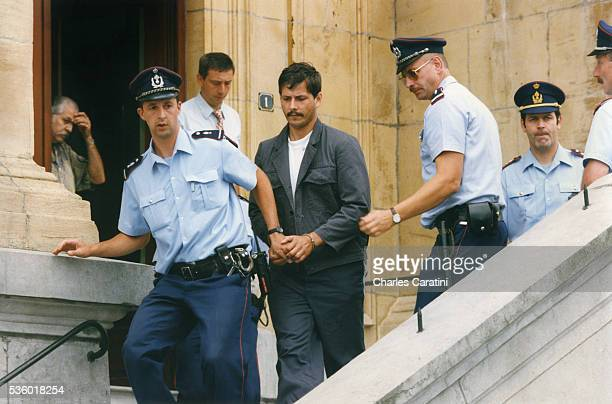 Belgian child rapist Marc Dutroux leaves the court of justice of Neufchateau