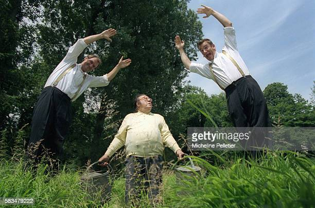 Belgian comedian Raymond Devos looks up as the Taloche Brothers jump into the air next to him Bruno Taloche and Vincent Taloche are two Belgian...