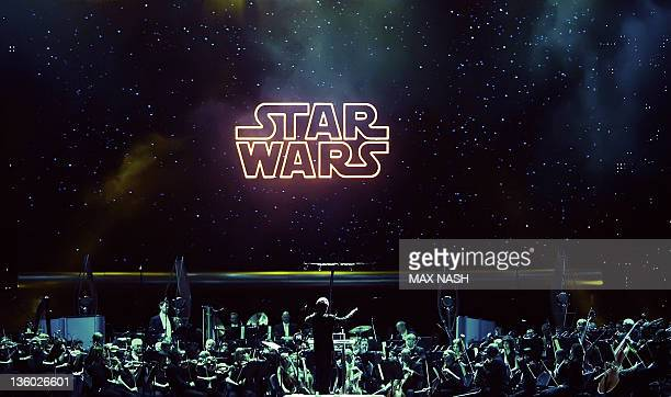 Belgian conductor Dirk Brosse takes the Royal Philharmonic Concert Orchestra through the 'Star Wars in Concert ' as title from one of the six Star...