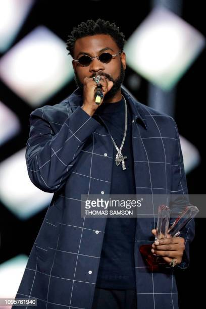 Belgian Congolese rapper William Kalubi aka Damso celebrates after receiving the best rap album award during the 34th Victoires de la Musique the...