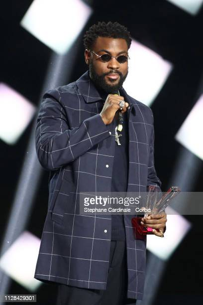 Belgian Congolese rapper William Kalubi aka Damso celebrates after receiving the best rap album award during the 34th 'Les Victoires De La Musique'...