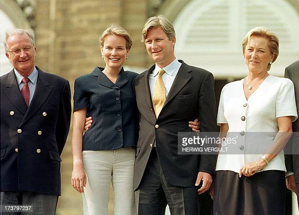 belgian Crown Prince Philippe and his fiancee Mathilde d'Udekem d'Acoz are flanked by King Albert II and Queen Paola during their first joint public...