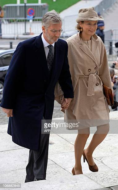 Belgian Crown Prince Philippe and his wife Princess Mathilde arrive for a Te Deum mass marking the King's Feast at the Saint Michael and St Gudula...