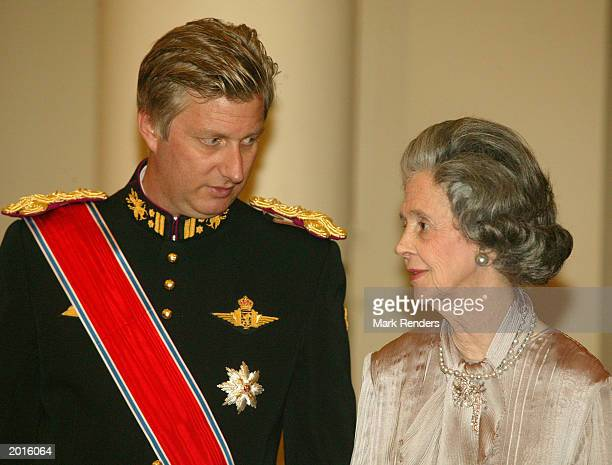 Belgian Crown Prince Philippe speaks with his aunt Queen Fabiola from Belgium May 20 2003 in Brussels Belgium King Harald and Queen Sonja from Norway...