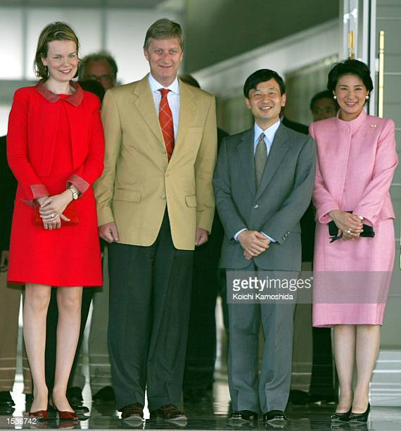 Belgian Crown Princess Mathilde and Prince Philippe greet Japanese Crown Princess Masako and Crown Prince Naruhito at the Tokyo International Airport...