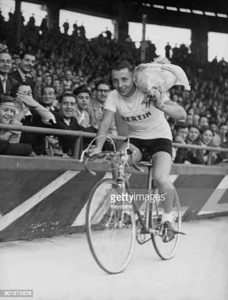 Belgian cycle racer Maurice Blomme arrives at the finish line in Parc des Princes Paris France to win the 141 km Grand Prix des Nations race 17th...