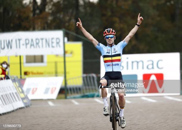 Belgian cyclist Eli Iserbyt crosses the finish line to win the men's elite race at the European Cyclocross Championships in Rosmalen, on November 8,...