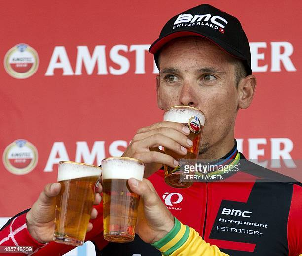 Belgian cyclist Phillipe Gilbert of BMC team drinks a beer on the podium after winning the 49th edition of the Amstel Gold Race 2518km cylcling race...