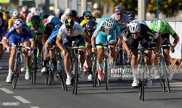Belgian cyclist Tom Boonen of the Omega Pharma Quick Step team sprints before crossing the finish line to win the fourth stage in the Qatar Tour 2014...