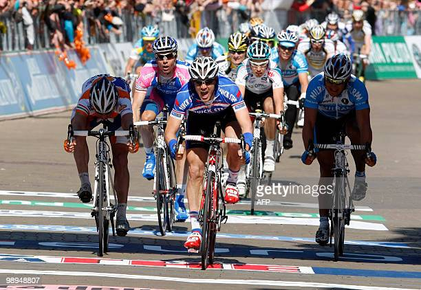 Belgian cyclist Wouter Weylandt of team QuickStep crosses the finish line to victory in the 3rd stage of the 93rd Giro d'Italia, a stage from...
