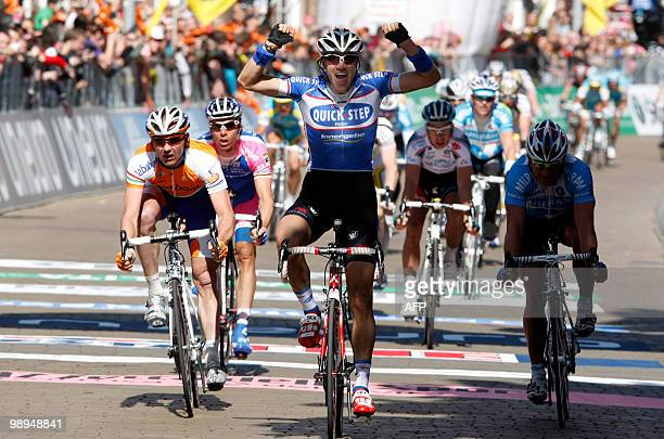Belgian cyclist Wouter Weylandt of team QuickStep crosses the finish line to victory in the 3rd stage of the 93rd Giro d'Italia a stage from...