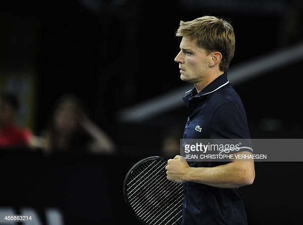 Belgian David Goffin celebrates after winning a point against his Portuguese opponent Joao Sousa during their ATP Moselle Open final tennis match on...