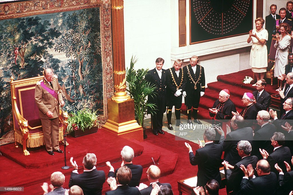 Belgian deputies and senators, Former Queen Fabiola and Queen Paola applause King Albert II after he delivered his constitutional oath of allegiance in the Belgian Parliament, Brussels on August 09, 1993. King Albert II succeeds his elder brother, Baudouin I, and becomes the 6th monarch of Belgium.