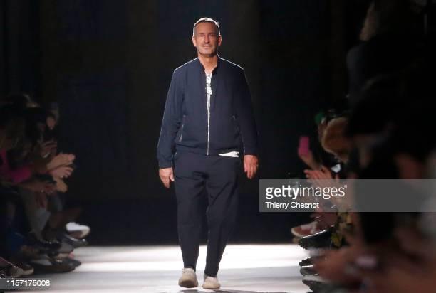 Belgian designer Dries Van Noten acknowledges the audience at the end of the Dries Van Noten Menswear Spring Summer 2020 show as part of Paris...