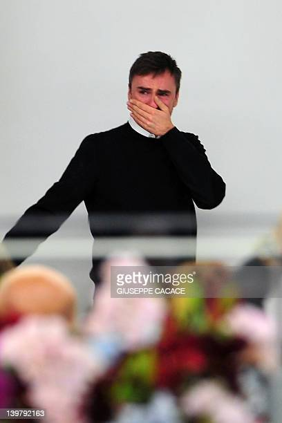 Belgian designer Raf Simons cries at the end of the Jil Sander Fall-winter 2012-2013 collection on February 25, 2012 during the Women's fashion week...