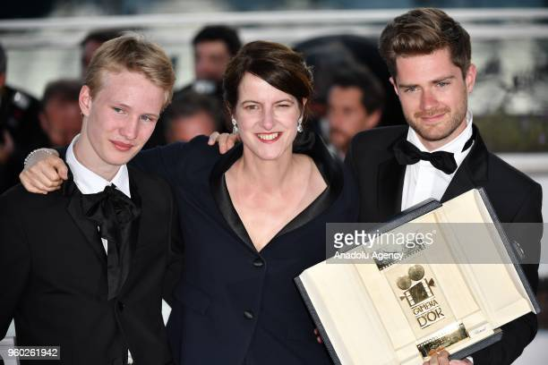 Belgian director Lukas Dhont poses with Ursula Meier and Victor Polster during the Award Winners photocall after he won the Camera d'Or Prize for...