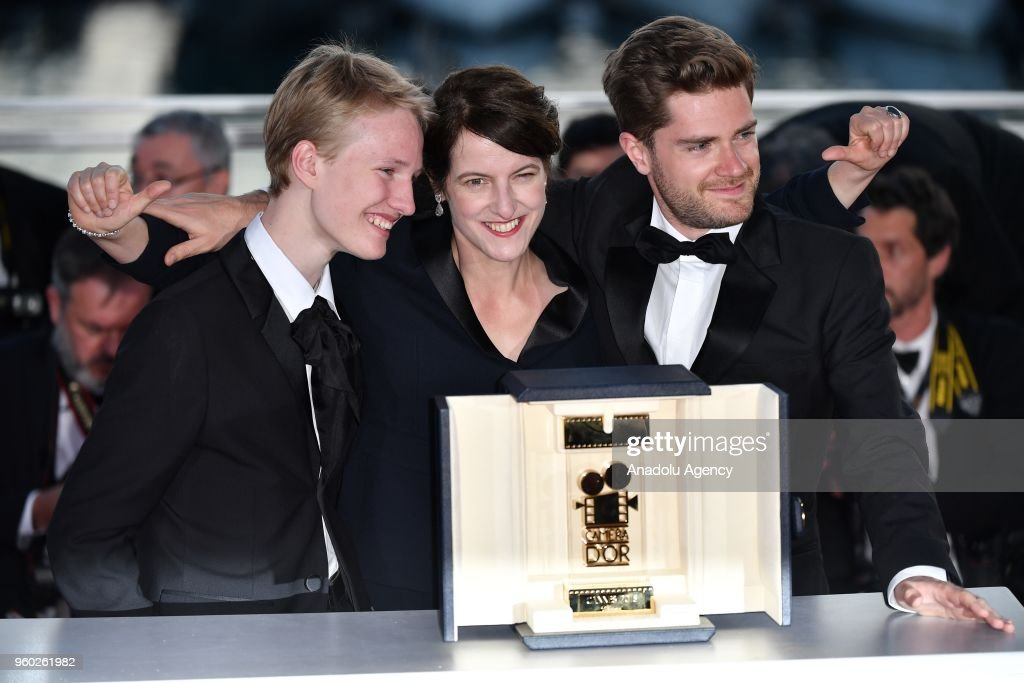 Belgian director Lukas Dhont (R) poses with Ursula Meier (C) and Victor Polster during the Award Winners photocall after he won the Camera d'Or Prize for 'Girl' at the 71st Cannes Film Festival in Cannes, France on May 19, 2018.