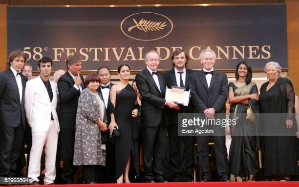 Belgian directors JeanPierre and Luc Dardenne pose with their Palme d'Or for the film L' Enfant along with actress and juror Salma Hayek Sarajevoborn...