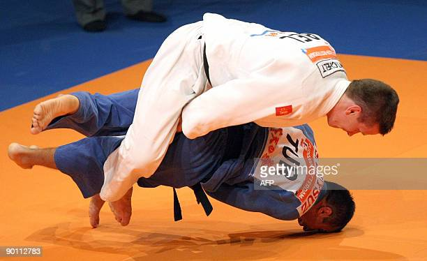 Belgian Dirk van Tichelt fights with Turkish Sezer Huysuz to take bronze medal in the men's 73kg class at the World Judo Championships in Rotterdam...