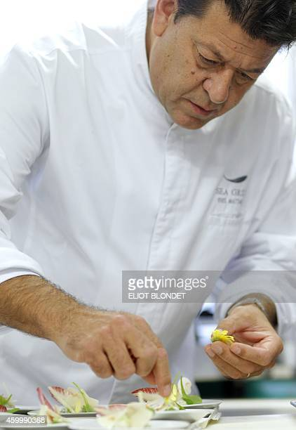 Belgian double starred chef Yves Mattagne prepares meals that will be served during Jet Airways business class flights on December 5 in his kitchen...