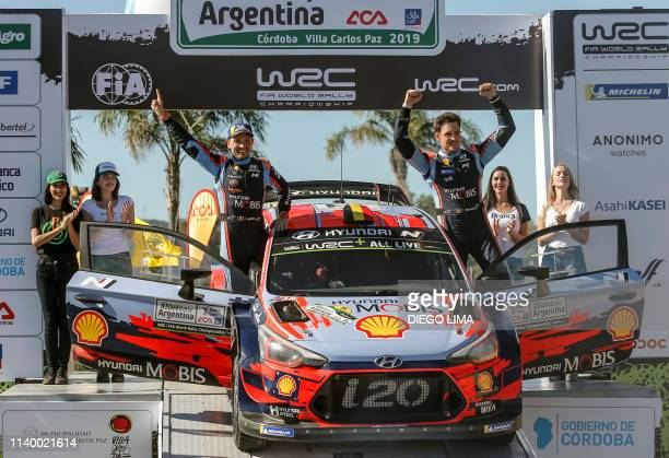 Belgian driver Thierry Neuville and his compatriot codriver Nicolas Gilsoul celebrate on the final podium of the WRC Argentina 2019 in Villa Carlos...