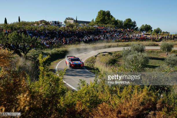 Belgian driver Thierry Neuville steers his Hyundai i20 Coupe WRC assisted by Belgian co-driver Nicolas Gilsoul during the third day of the Catalonia...