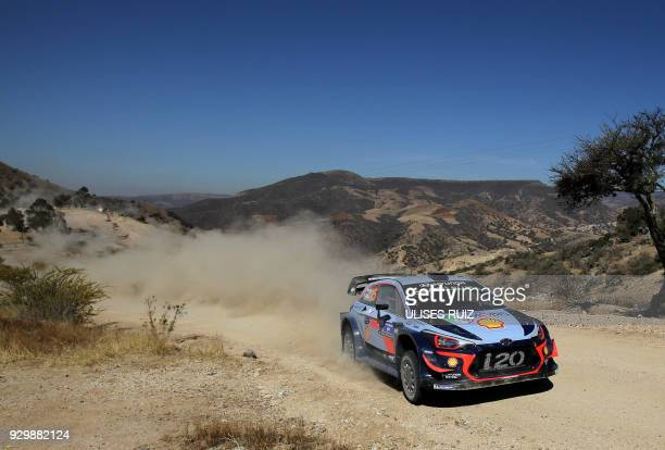 Belgian driver Thierry Neuville steers his Hyundai i20 Coupe WRC with compatriot codriver Nicolas Gilsoul during the first day of the 2018 FIA World...