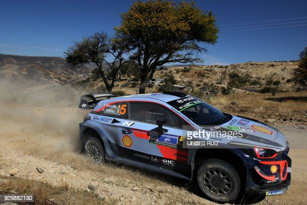 TOPSHOT Belgian driver Thierry Neuville steers his Hyundai i20 Coupe WRC with compatriot codriver Nicolas Gilsoul during the first day of the 2018...