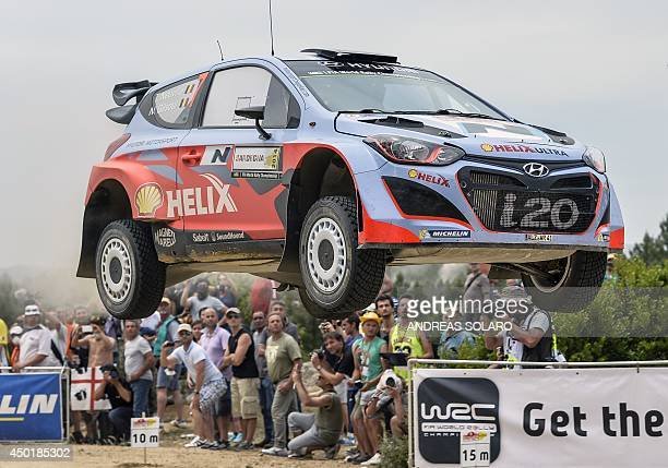 Belgian driver Thierry Neuville with his compatriot copilot Nicolas Gilsoul take a jump with their Huyndai I20 WRC as they compete during the fourth...
