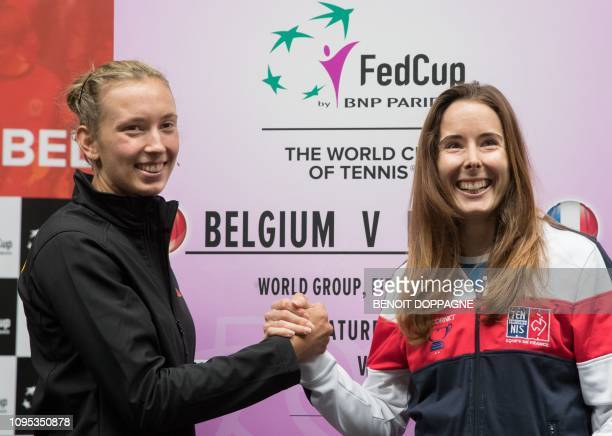 Belgian Elise Mertens and French Alize Cornet pose for photographers after the draw of the playing schedule for this weekend's quarterfinal of the...