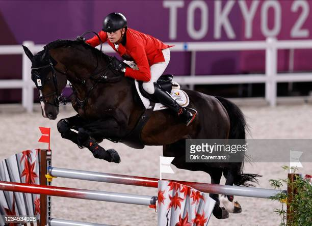 Belgian Equestrian jumping rider Jerome Guery and his horse Quel Homme de Hus pictured in action during the final of the team jumping competition on...
