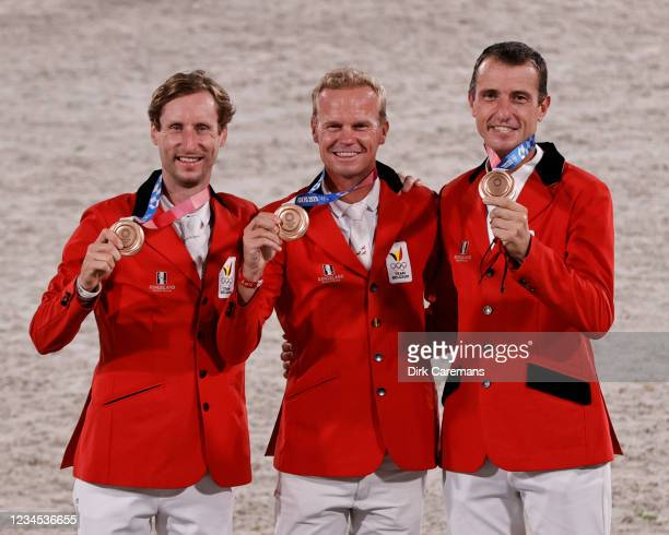 Belgian Equestrian jumping rider Pieter Devos, Belgian Jerome Guery and Belgian Gregory Wathelet celebrate their bronze medal during the medal...