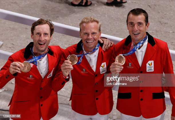 Belgian Equestrian jumping riders Pieter Devos, Jerome Guery and Gregory Wathelet pose with their medal after the medal ceremony of the team jumping...