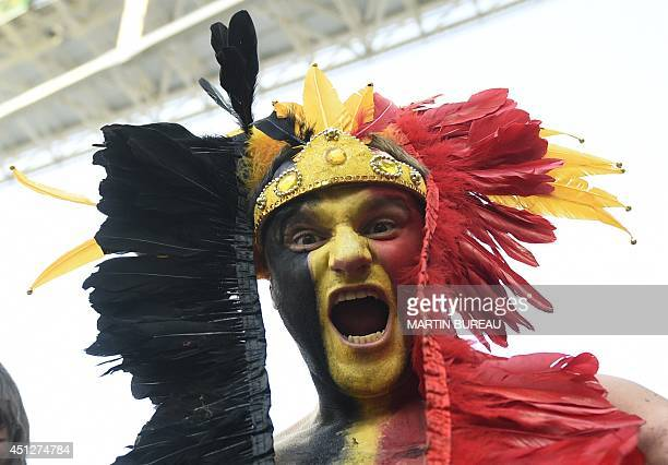A Belgian fan reacts prior to a Group H football match between South Korea and Belgium at the Corinthians Arena in Sao Paulo during the 2014 FIFA...