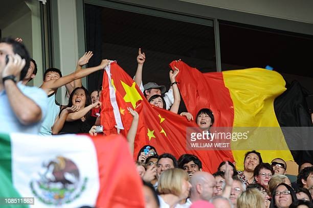 Belgian fans with a national flag cheer for Kim Clijsters of Belgium as Chinese fans with a national flag cheer for Li Na of China in their women's...