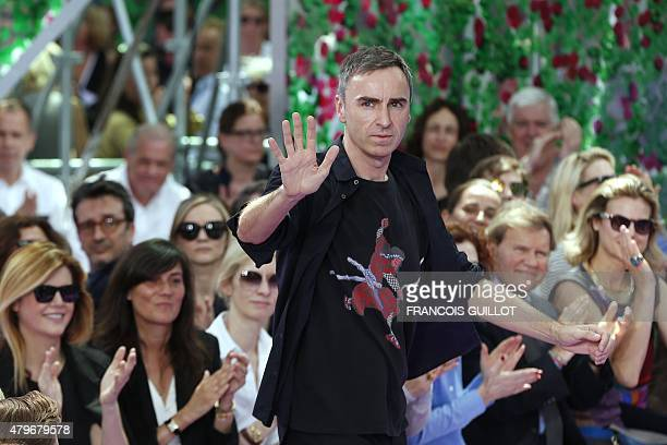 Belgian fashion designer Raf Simons acknowledges the public during the Christian Dior 2015-2016 fall/winter Haute Couture collection fashion show on...