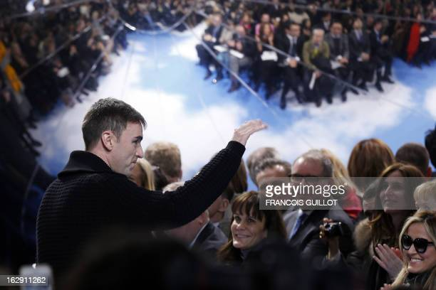Belgian fashion designer Raf Simons for Christian Dior acknowledges the public during the Fall/Winter 20132014 readytowear collection show on March 1...