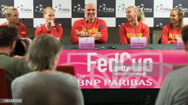 Belgian Fed Cup team's Ysaline Bonaventure Alison Van Uytvanck captain Johan Van Herck Elise Mertens and Kirsten Flipkens hold a press conference...