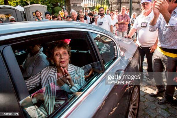 Belgian film actress Annie Cordy is greeted by fans as she arrives for the opening of a park named after her in Laeken Brussels on July 8 2018 /...