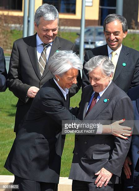 Belgian Finance Minister Didier Reynders with Cyprus counterpart Charilaos Stavrakis view French Economy Minister Christine Lagarde talking to the...