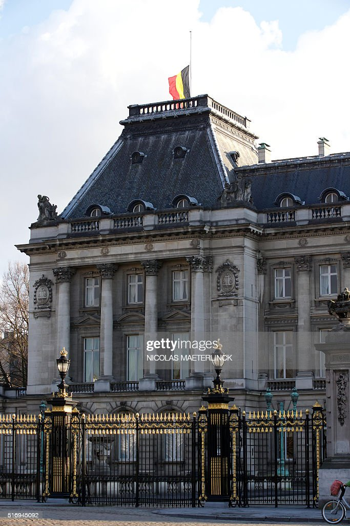 Belgian flag flies at half mast above the Royal Palace in Brussels on March 22, 2016 in the wake of co-ordinated attacks claimed by Islamic State group (IS) millitants at the city's airport and in a Metro train. Belgium will hold three days of national mourning in the wake of the deadly attacks in the capital Brussels that killed around 35 people. 'All national flags on public buildings will be at half-mast,' Frederic Cauderlier, spokesman for Belgian premier Charles Michel, told AFP. MAETERLINCK / Belgium OUT