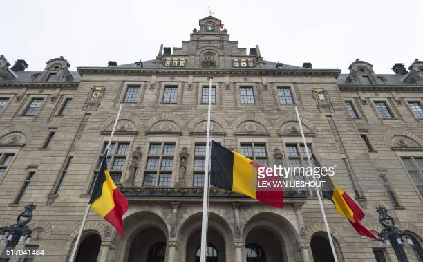 Belgian flags flying at halfmast at the city hall in Rotterdam on March 23 a day after coordinated bomb attacks in Brussels left 31 dead and 270...