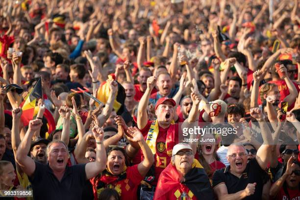 Belgian football fans celebrate their teams opening goal during the World Cup Quarter Final match between Brazil and Belgium at a fan village on July...