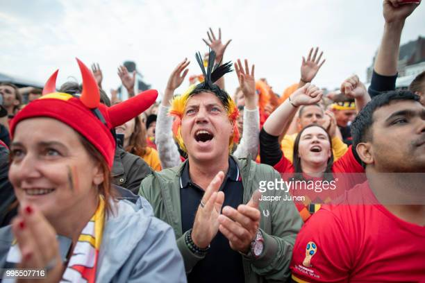 Belgian football fans cheer at the start of the World Cup Semi Final match between France and Belgium at a fan village on July 10, 2018 in Antwerpen,...