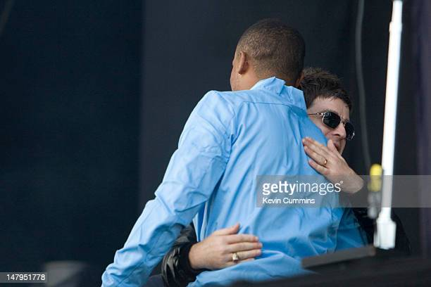 Belgian footballer and Manchester City captain Vincent Kompany hugs Noel Gallagher as he introduces him on stage at the Rock Werchter Festival...