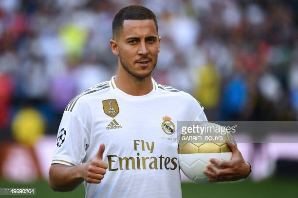 Belgian footballer Eden Hazard gives a thumbsup during his official presentation as new player of the Real Madrid CF at the Santiago Bernabeu stadium...