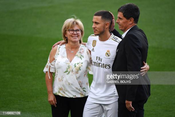 Belgian footballer Eden Hazard poses with his mother Carine and his father Thierry during his official presentation as new player of the Real Madrid...