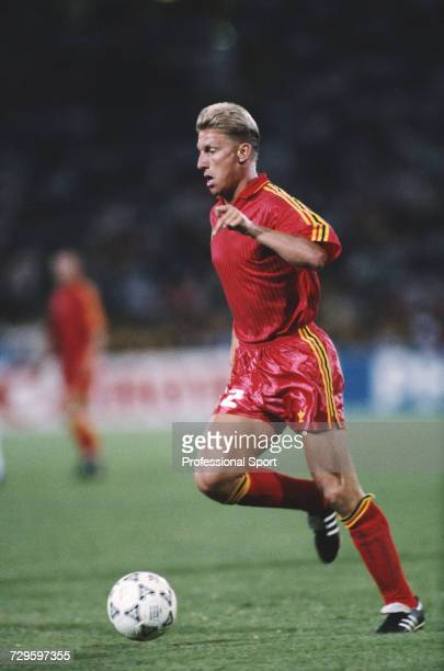 Belgian footballer Patrick Vervoort makes a run with the ball during the Round of 16 match between England and Belgium in the 1990 FIFA World Cup at...