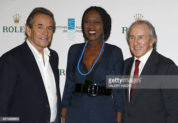 Belgian former racing driver Jacky Ickx his wife Burundian singer Khadja Nin and British former Formula One racing driver Jackie Stewart pose during...